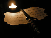Poem. On burnt paper and paper cutter royalty free stock images