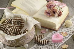 Poem book with heart-shaped candle. And home made cookies Stock Image