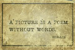 Poem without Horace quote. A picture is a poem without words - ancient Roman philosopher Horace quote written on framed chalkboard royalty free stock image