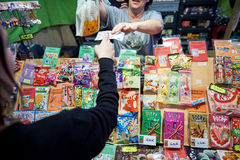 Poeple buying jelly and other japanese sweet Royalty Free Stock Photos