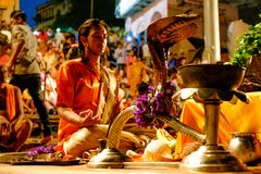 Varanasi, India - 16 september 2018: close up of young hindu priest praying in daily ritual ganga aarti ceremony with fire and stock images