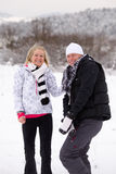 Poeple in winter. Young people in the snow Stock Photography