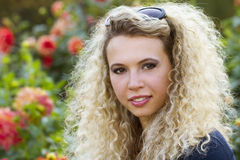 Poertrait of the curly blond girl Royalty Free Stock Images