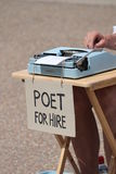 Poet for hire with typewriter writer. Poet for hire with typewriter and sign writer royalty free stock photos