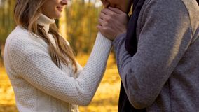 Poet kissing hands of his beloved woman, romantic atmosphere in autumn wood royalty free stock photos