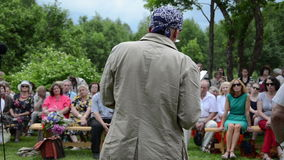 Poet people audience. Famous poet read this works creation in rural poetry festival and urban people audience enjoy it on June 09, 2013 in Juknenai, Lithuania stock video footage