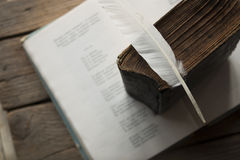 Poet, writer, literature idea. Old book, book of poems and a feather royalty free stock image