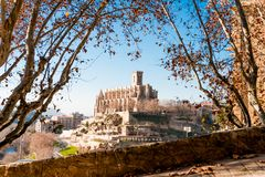 Different and original view of Collegiate Basilica of Santa Maria Seu in Manresa city in catalunya region in Spain, with trees and. Poetic view of Ancient church royalty free stock image