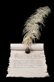 Poetry. On old paper scroll. Quill pen and ink in focus Royalty Free Stock Images