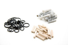 Poetry with dowel. Washers of rubber and dowel royalty free stock photo