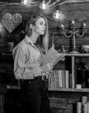 Poetry evening concept. Girl reading poetry in warm atmosphere. Girl in casual outfit in wooden vintage interior enjoy. Poetry. Lady on dreamy face in plaid royalty free stock image