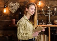 Poetry evening concept. Girl reading poetry in warm atmosphere. Lady on dreamy face in plaid clothes holds book, reading royalty free stock image