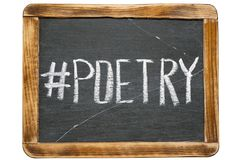 Poetry hashtag. Handwritten on vintage school slate board isolated on white stock images