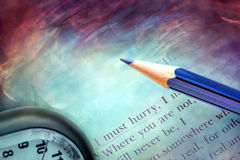 Poetry lines, pencil and clock Stock Images