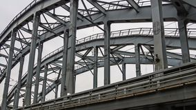 Poetry of metal structures of St. Petersburg. View of American bridges from the sidewalk stock photography