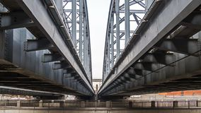Poetry of metal structures of St. Petersburg. View of American bridges from the sidewalk stock photos