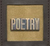POETRY word framed. POETRY word assembled from vintage wooden letterpress inside stitched leather frame Royalty Free Stock Photos