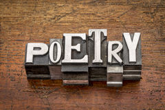 Poetry word in metal type Stock Photos