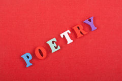 POETRY word on red background composed from colorful abc alphabet block wooden letters, copy space for ad text. Learning Stock Photography