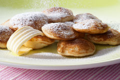 Poffertjes with powdered soft sugar Royalty Free Stock Images