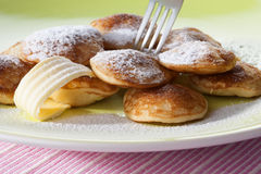 Poffertjes with powdered soft sugar and fork Stock Photos