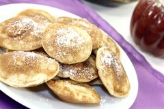 Poffertjes with powdered sugar and jelly Royalty Free Stock Image