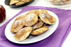 Poffertjes with sweet powdered sugar Stock Photos