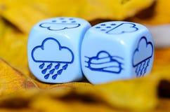 Pogoda pokazywać na kostka do gry pogodzie jesień Obrazy Stock