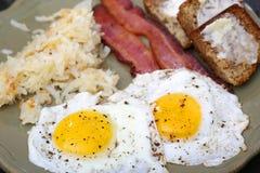 Pogodna strona w górę jajecznego śniadania Obraz Stock