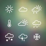 Pogodowe ikony na blured tle Zdjęcia Royalty Free
