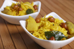 Poha - A breakfast snack made of beaten rice Stock Photos