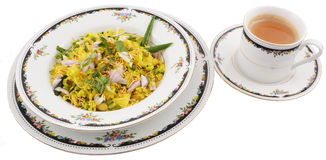 Poha with cup of tea Stock Images