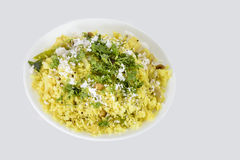 Poha or pohe Indian snack. Popular Indian snack Poha or pohe made with beaten rice Royalty Free Stock Image