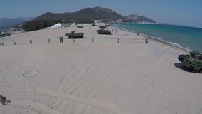 POHANG KOREA, MARCH 2016 Drone flight over landing amphibious tanks and soldiers stock video footage