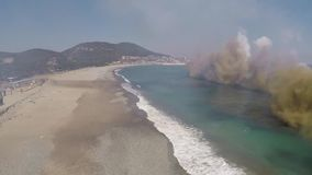 POHANG KOREA, MARCH 2016, Smoke flows through a beach. stock video footage