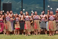 Poi dance by Maori women, New Zealand. The female section of a kapa haka, or traditional Maori dance group. They are swinging poi, light balls on the end of a royalty free stock photos