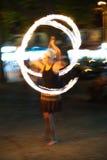 Poi fire show. To entertain tourists in Sozopol city, Bulgaria. Motion blur Stock Photos