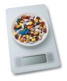 Poids d'échelle de pilules de régime Photographie stock libre de droits