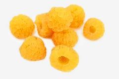 Poignée de framboises jaunes Images libres de droits