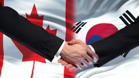 Poignée de main de Canada et de la Corée du Sud, amitié internationale, fond de drapeau banque de vidéos