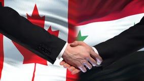 Poignée de main de Canada et de la Syrie, relations internationales d'amitié, fond de drapeau clips vidéos