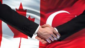 Poignée de main de Canada et de la Turquie, relations internationales d'amitié, fond de drapeau clips vidéos