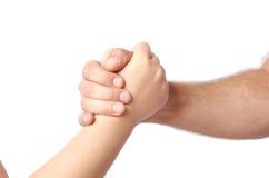 Poignée de main d'homme et d'enfant au-dessus du blanc Photographie stock
