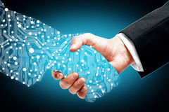 Poignée de main de Digital sur le fond bleu image libre de droits