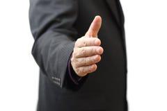 Poignée de main de offre d'homme d'affaires à vous image libre de droits