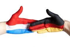 Poignée de main entre l'Allemagne et les Hollandes Photographie stock
