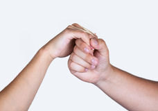 Poignée de main hommes-femmes de mains d'isolement sur le blanc Images stock
