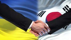 Poignée de main de l'Ukraine et de la Corée du Sud, amitié internationale, fond de drapeau clips vidéos
