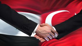 Poignée de main de la Syrie et de la Turquie, sommet international d'amitié, fond de drapeau banque de vidéos