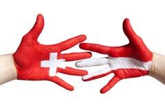 Poignée de main suisse et autrichienne Photographie stock